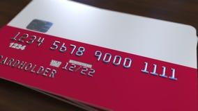 Carte de banque en plastique comportant le drapeau de la Pologne Rendu 3D relié au système d'opérations bancaires nationales Photos libres de droits
