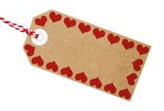 Carte de Brown d'étiquette de cadeau avec la frontière de coeur d'amour Photographie stock