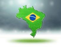 Carte de conception du Brésil avec la texture d'herbe des terrains de football Photo stock