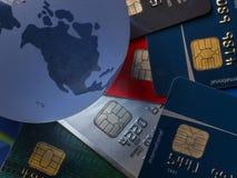 Carte de crédit de globe Photos libres de droits