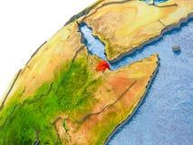 Carte de Djibouti en rouge sur le globe illustration stock