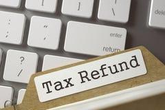 Carte de dossier avec le remboursement d'impôt fiscal d'inscription 3d Photographie stock