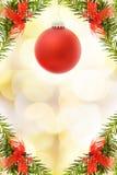 Carte de fête de Noël avec la babiole rouge Image libre de droits