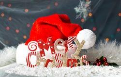Carte de fête de fond de Joyeux Noël avec le chapeau de Santa photos stock