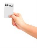 Carte de fixation de main avec le mot quand Images stock
