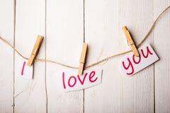 Carte de jour de valentines avec des coeurs et des mots de l'amour Photo libre de droits
