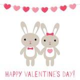 Carte de jour du ` s de Valentine avec des couples de lapins Image libre de droits