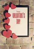 Carte de jour du ` s de Valentine avec le cadre de coeurs Photographie stock