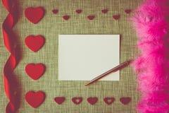 Carte de jour du ` s de Valentine sur le fond de tissu photo stock