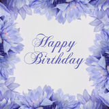 Carte de joyeux anniversaire avec des fleurs Photographie stock libre de droits