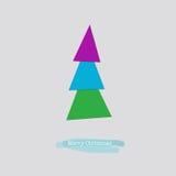 Carte de Joyeux Noël avec l'arbre vert rose bleu Photographie stock