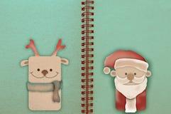 Carte de Joyeux Noël avec les cerfs communs et le père noël et les décorations Photos libres de droits