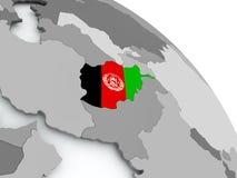 Carte de l'Afghanistan avec le drapeau sur le globe Images stock