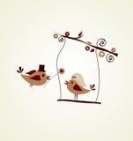 Carte de mariage ; oiseau de marié donnant une fleur Images stock