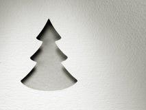 Carte de monochrome de vintage de conception de coupe de papier d'arbre de Noël Photographie stock