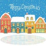 Carte de Noël avec les maisons neigeuses illustration stock