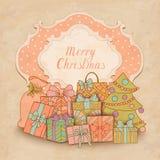 Carte de Noël de vintage avec des boîte-cadeau Photos stock