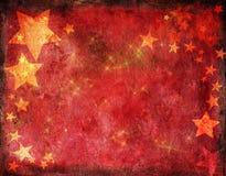 Carte de Noël rouge avec des étoiles d'or Image stock