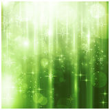 Carte de Noël verte élégante avec les lumières de pétillement Photographie stock