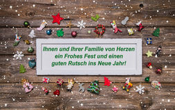 Carte de Noël avec la décoration colorée et le texte allemand joyeux ch Photo stock