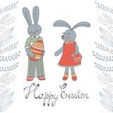 Carte de Pâques heureuse avec les lapins de Pâques mignons Photo stock