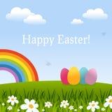 Carte de Pâques heureuse avec les oeufs et l'arc-en-ciel Image stock