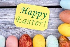 Carte de Pâques heureuse, oeufs colorés Images libres de droits