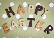 Carte de Pâques heureuse sur le tissu vert gris Photographie stock