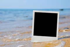 Carte de photo sur le sable Photographie stock