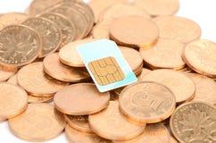 Carte de pièce de monnaie et de sim Photographie stock