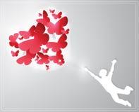 Carte de Saint-Valentin représentant un garçon guidé par des papillons Images stock