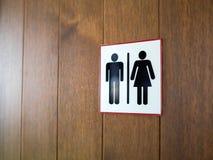 Carte de travail/icône de signe, d'homme et dame de toilette sur le fond en bois images stock