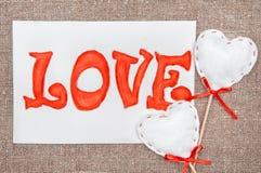Carte de Valentine avec amour de mot de dessin Images stock