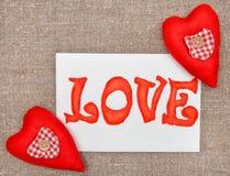 Carte de Valentine avec amour de mot de dessin Photographie stock