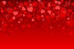 Carte de Valentine avec un fond de coeurs Image libre de droits