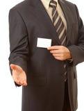 Carte de visite professionnelle de visite dans la main de l'homme d'affaires Images stock