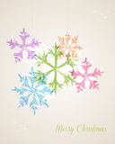 Carte de voeux accrochante de flocon de neige de Joyeux Noël Photographie stock libre de droits