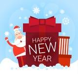 Carte de voeux de bonne année de vacances de Noël de Santa Claus With Big Present Box Image libre de droits