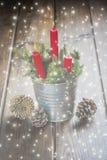 Carte de voeux de Noël avec des bougies Photographie stock