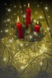 Carte de voeux de Noël avec des bougies Images stock