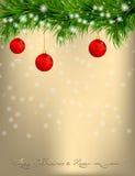Carte de voeux de Noël avec des brindilles et des boules de sapin Photos stock