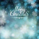 Carte de voeux de Noël avec le fond de tache floue et le lettrage tiré par la main Photographie stock