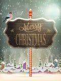 Carte de voeux de vintage de Noël sur le village d'hiver Images libres de droits