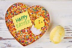 Carte de voeux et bonbons de Pâques Photographie stock libre de droits