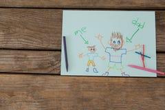 Carte de voeux et crayons de jour de pères sur la table en bois Photos stock