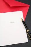 Carte de voeux et enveloppe rouge Photos stock