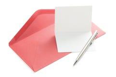 Carte de voeux et enveloppe rouge Photographie stock libre de droits