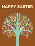 Carte de voeux heureuse bleue d'arbre de Pâques avec des oeufs dedans Images libres de droits