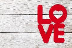 Carte de voeux de jour de valentines avec le mot d'amour Images stock