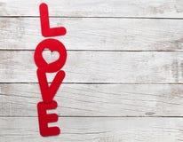Carte de voeux de jour de valentines avec le mot d'amour Photo libre de droits